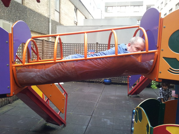 Me getting stuck in the hospital playground caused great amusement to my entire family. Rather than help me out they took time to take a photo!